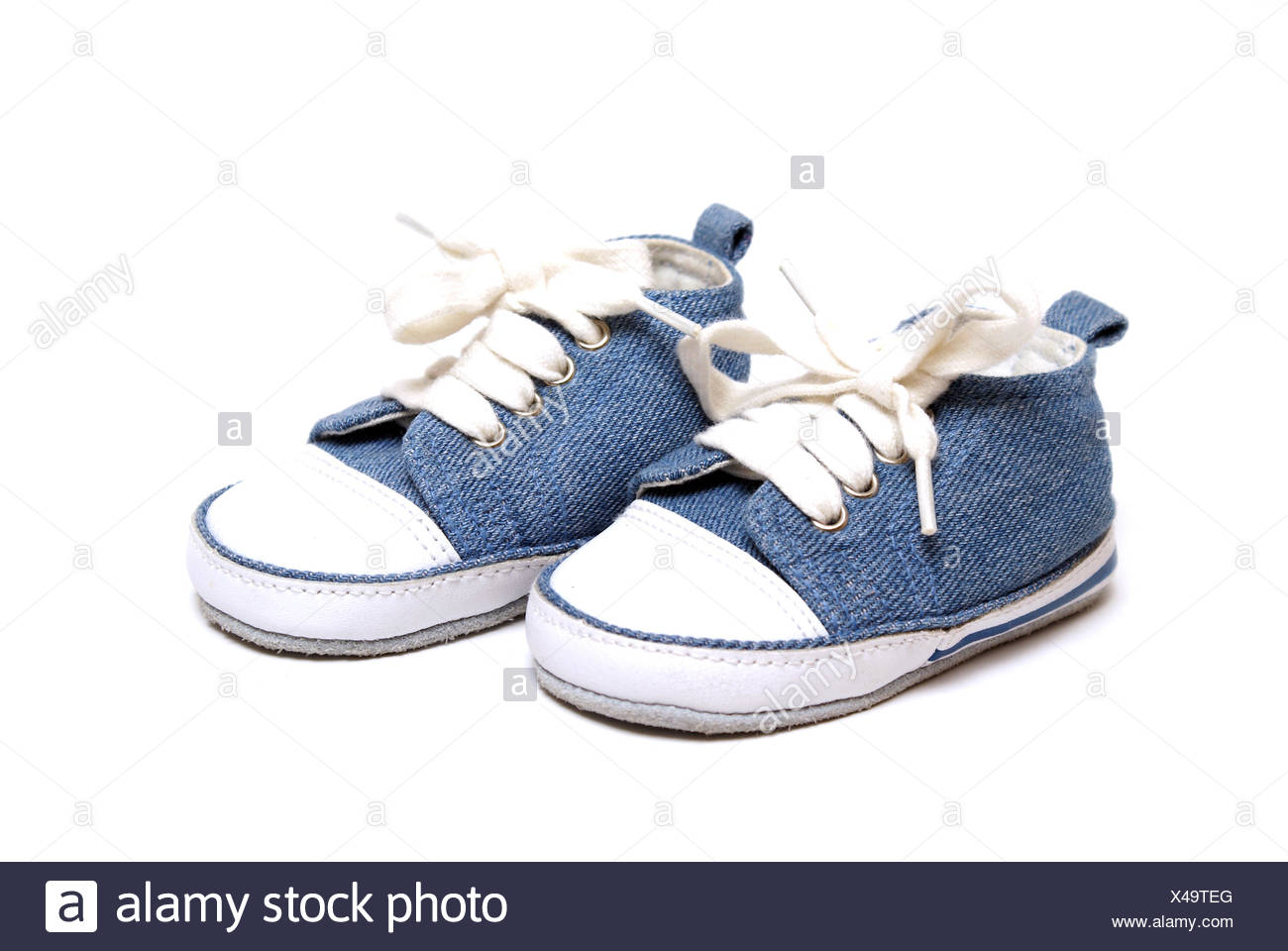 blue isolated fashion born closeup new shoes small tiny little short baby feet mother mom ma mommy accessories accessory - Stock Image