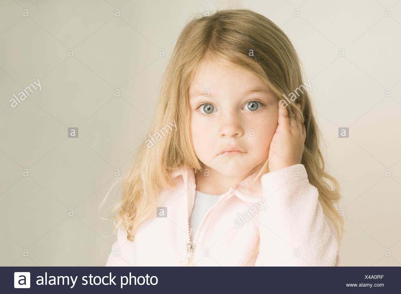 portrait of little girl with long blond hair - Stock Image