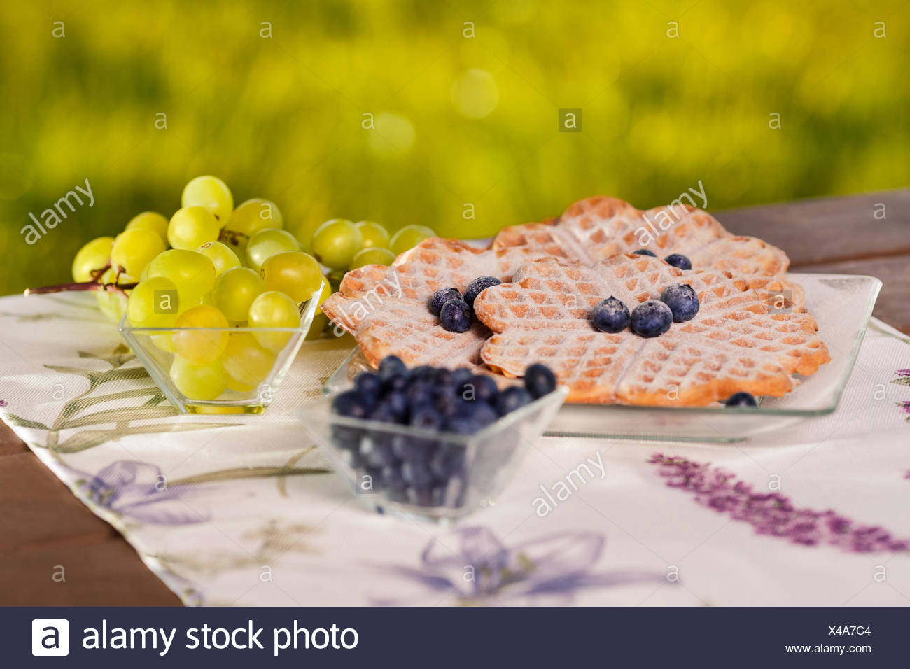 Close up of belgian waffles with fruits outdoors. Debica, Poland - Stock Image