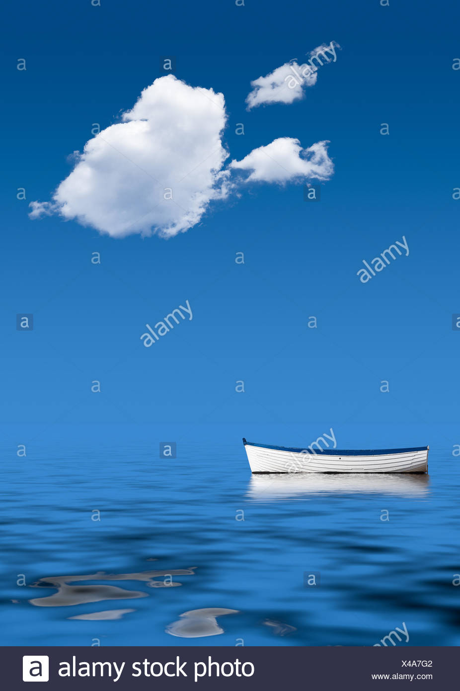 Old rowing boat marooned at sea - Stock Image