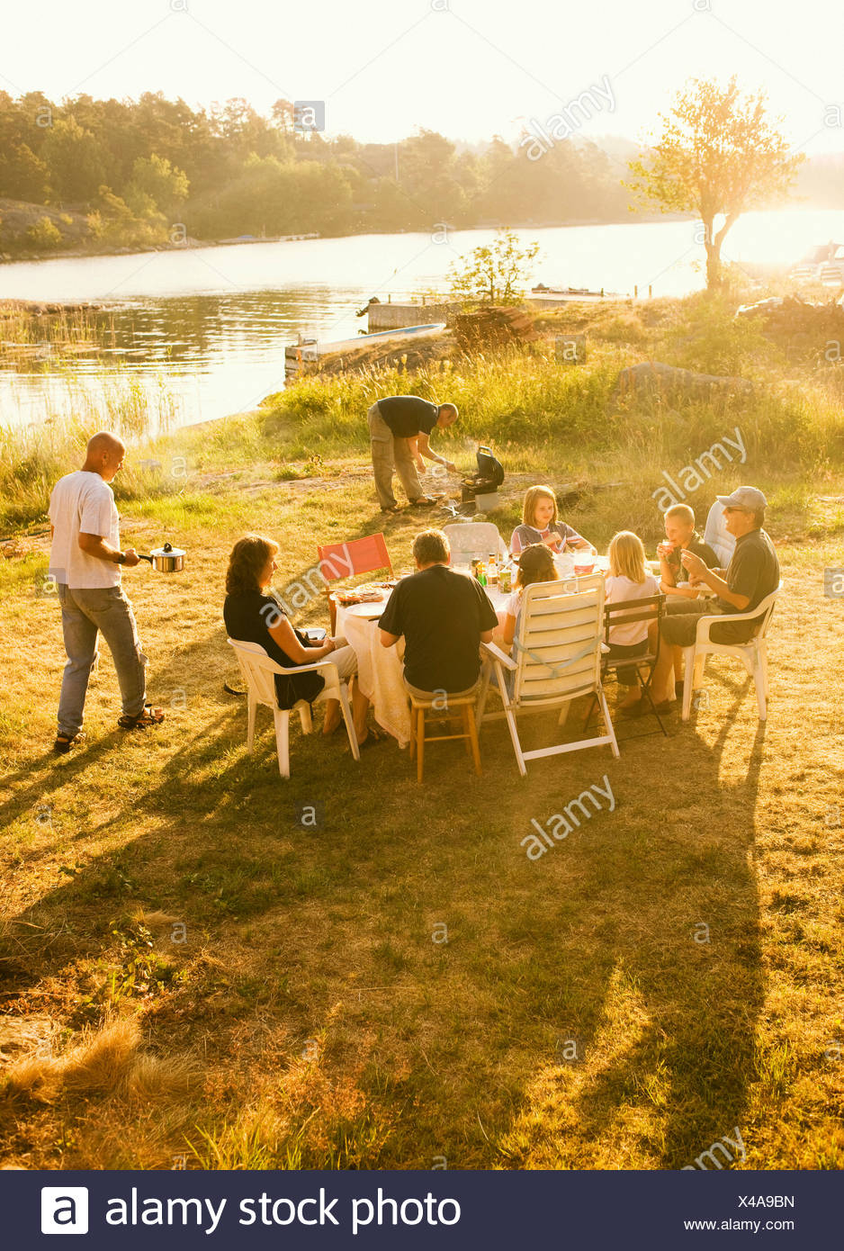 A picnic a summer night Sweden. - Stock Image