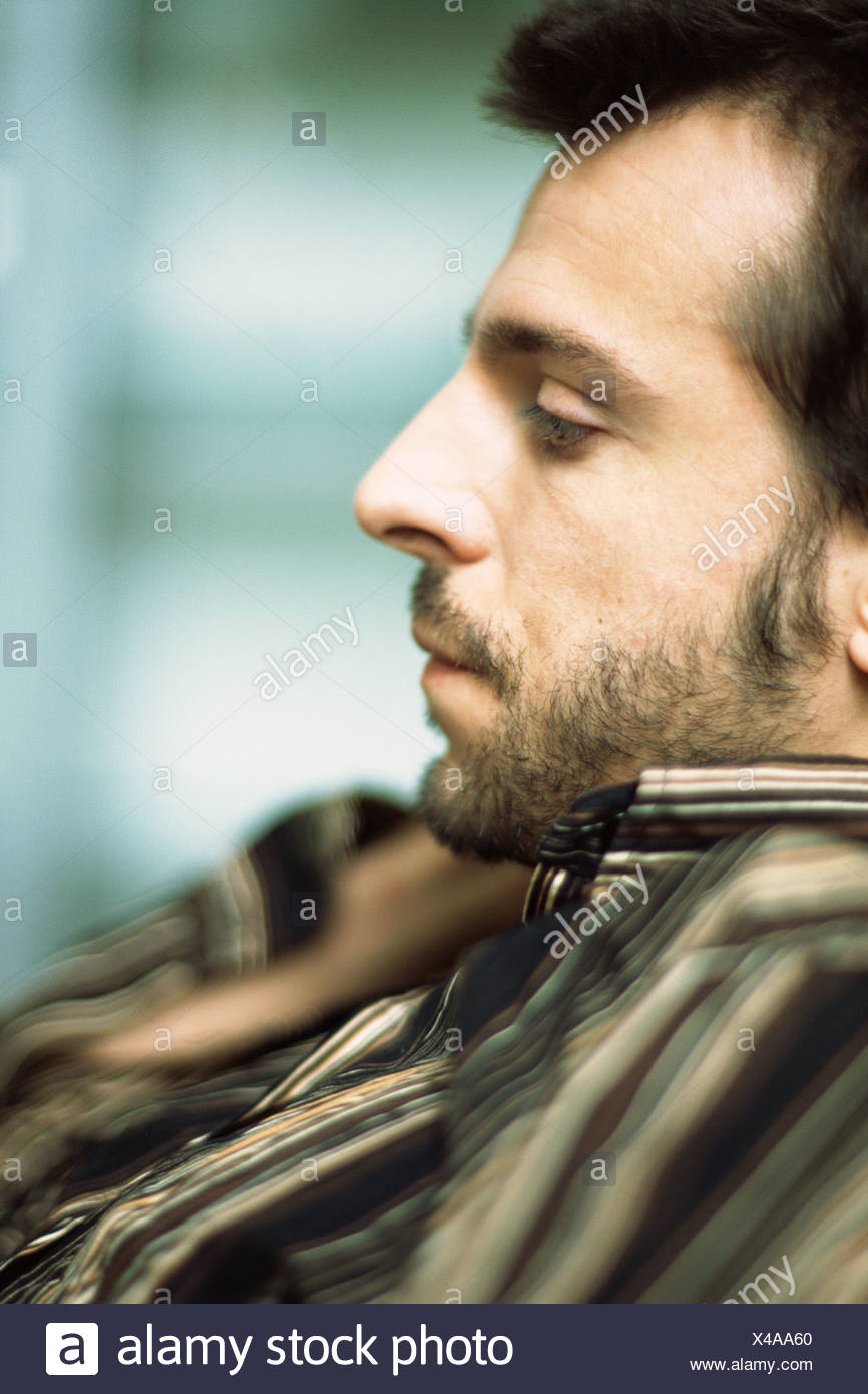 Young man, side view - Stock Image