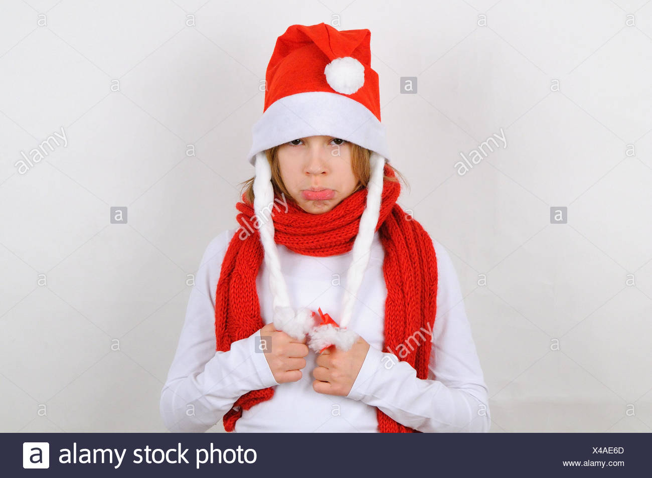 Girl, Santa's hat, view camera, defiantly, Christmas, winter, Santa, Santa's hat, person, child, scarf, red, gesture, offends, sulk, lining, Stock Photo
