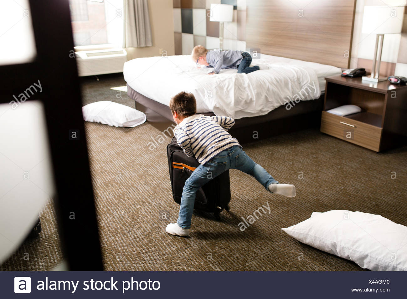 Two boys play in a motel room Stock Photo: 278057136 - Alamy
