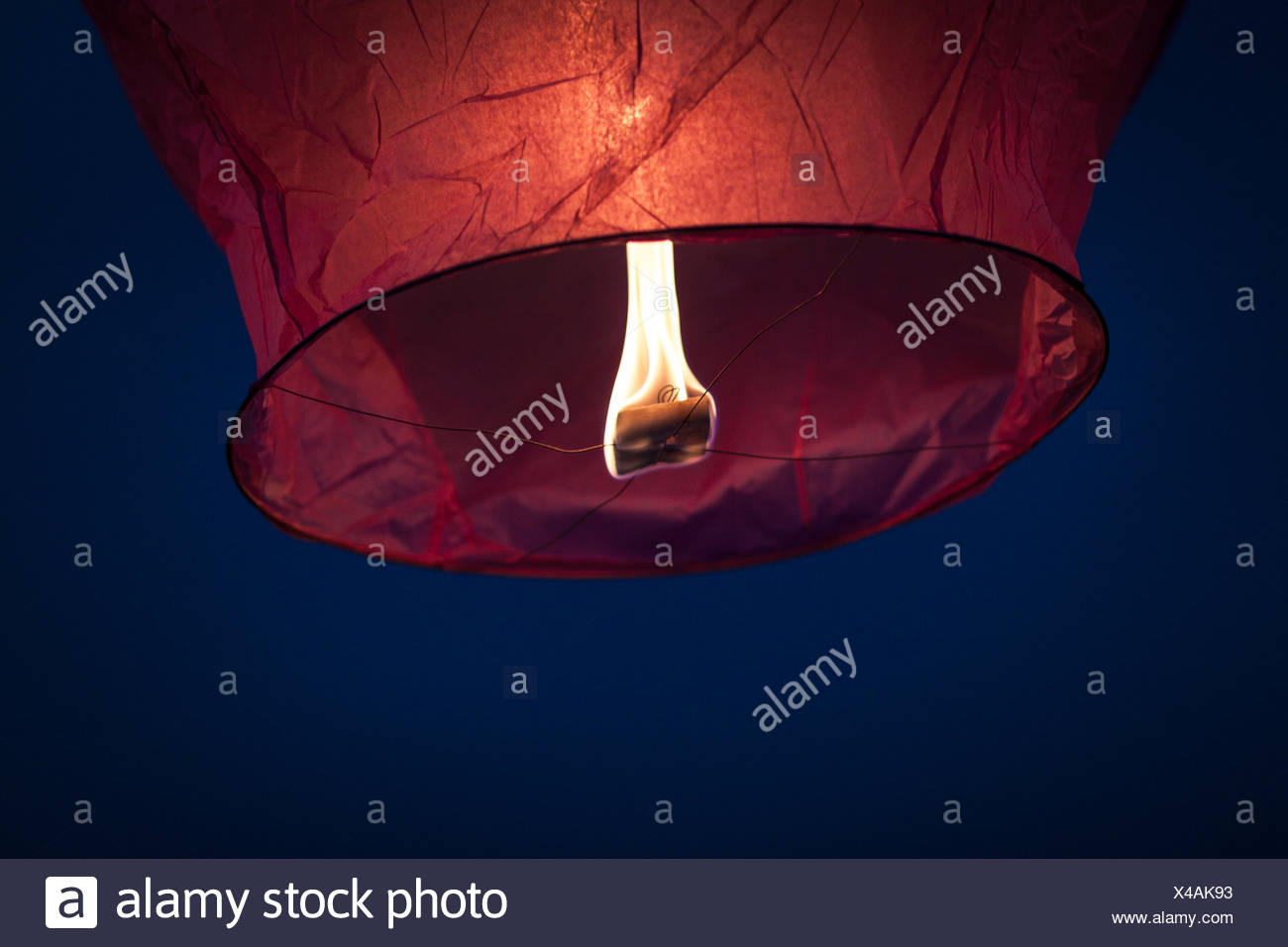 Low Angle View Of Lit Sky Lantern At Night - Stock Image