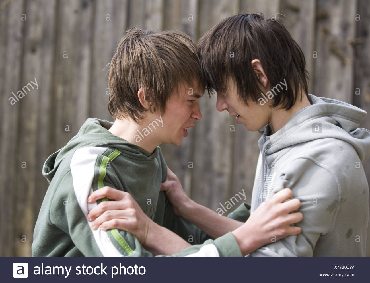 Young persons,aggression,fight,tread,boy,teenager,youth,fury,violent,fight,scuffle,fight,enemies,rivals,rage,fight,fight,outside,power, - Stock Image