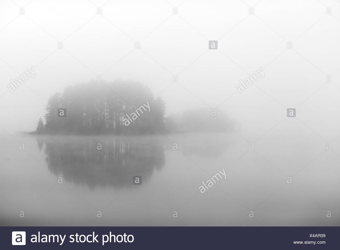 An Island Shrouded In Fog Sweden Stock Photo Alamy