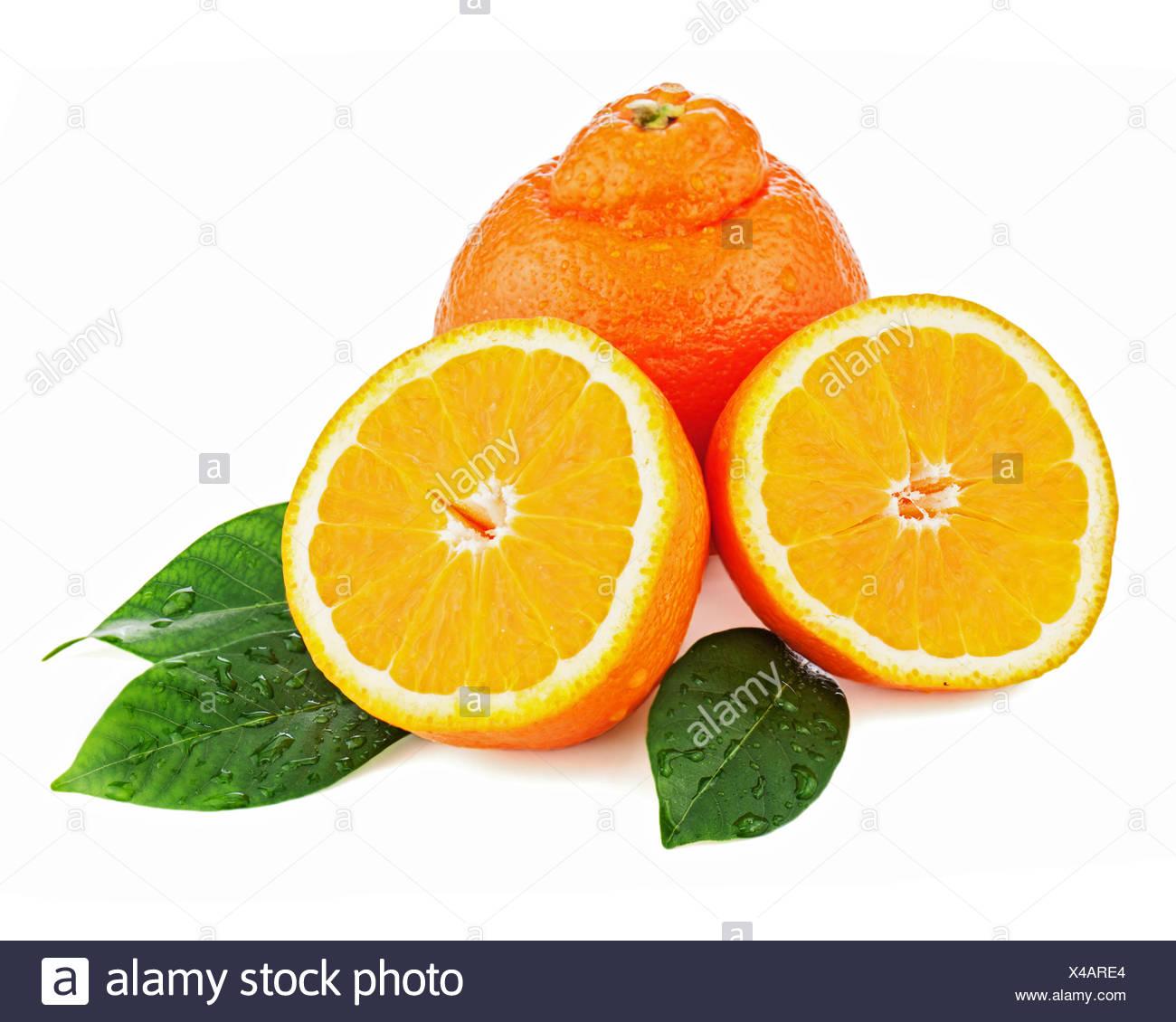Fresh orange fruit with green leaves isolated on white background. Closeup. - Stock Image