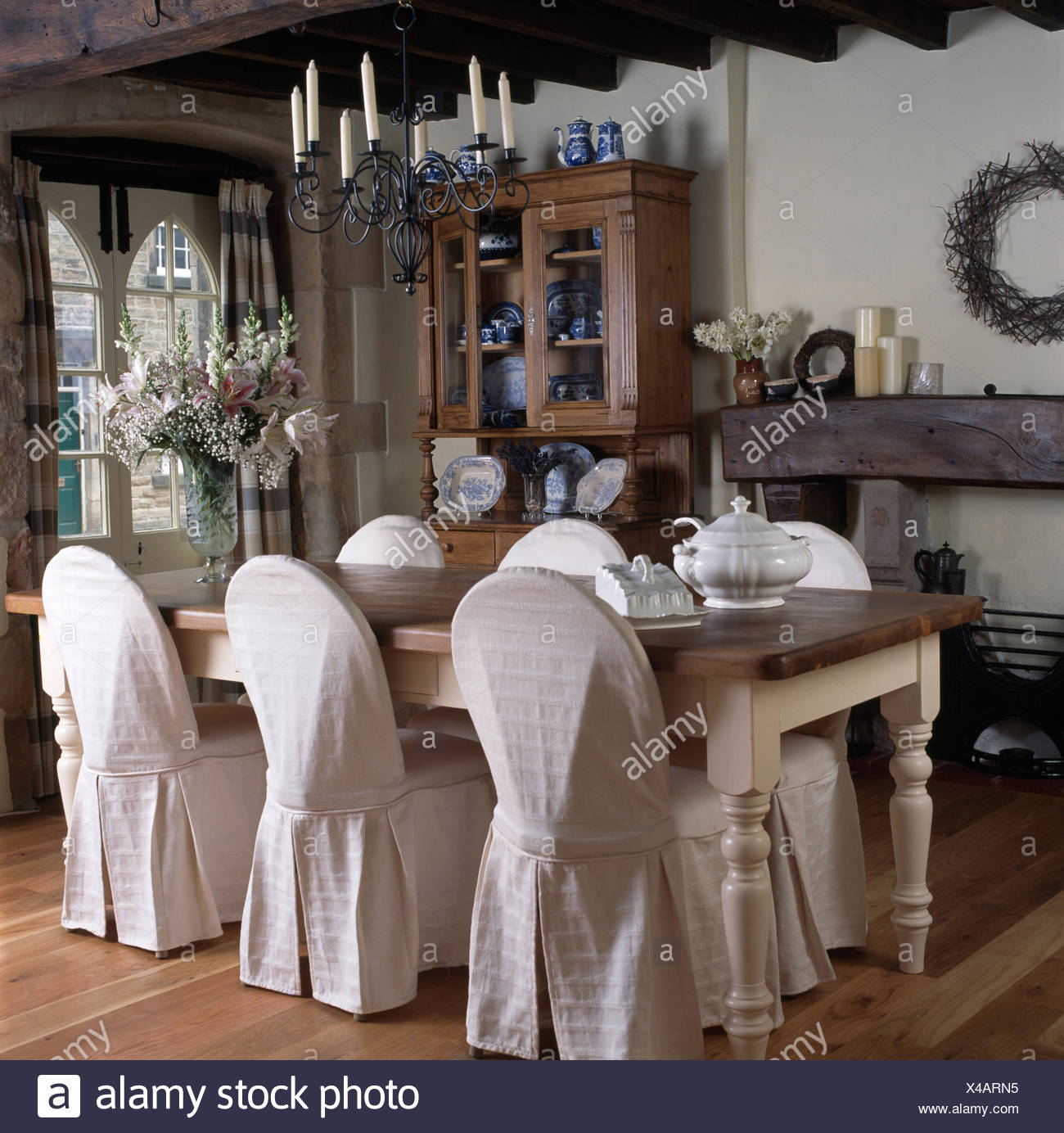 Cool Candle Chandelier Above Painted Dining Table And Chairs With Beutiful Home Inspiration Xortanetmahrainfo