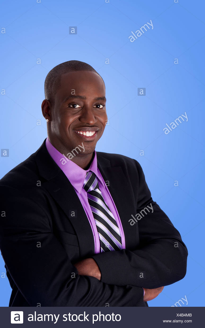742f8790822 Handsome happy African American corporate business man smiling ...