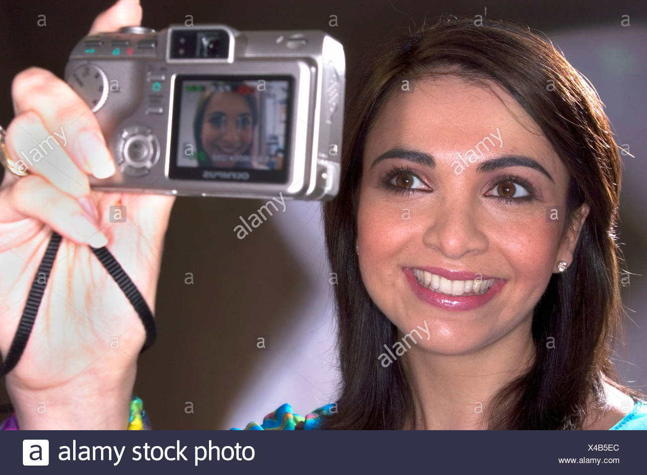 photo digital camera photo camera woman portrait face laughing laughter selfportrait - Stock Image