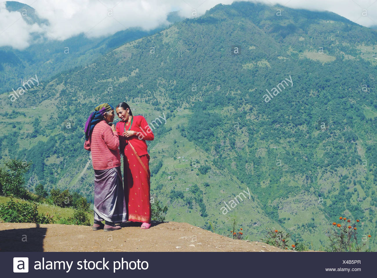 Nepal, Women standing and talking in mountains - Stock Image