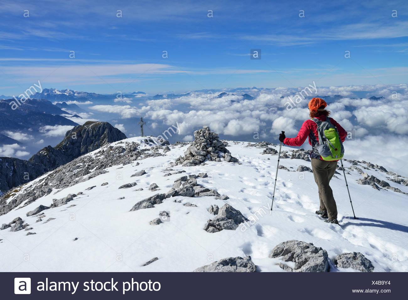 Woman descending from Hoher Goell, Dachstein range in background, Berchtesgaden National Park, Berchtesgaden Alps, Upper Bavaria, Bavaria, Germany Stock Photo