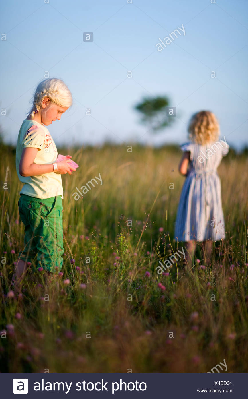 Two girls on meadow - Stock Image