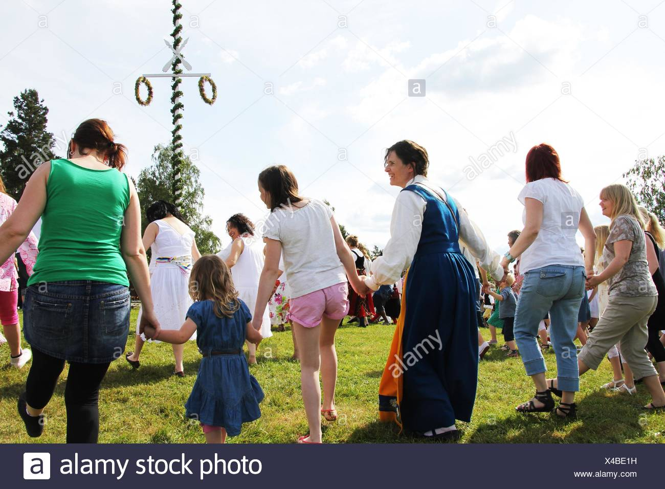 Dance around the maypole on midsummer - Stock Image