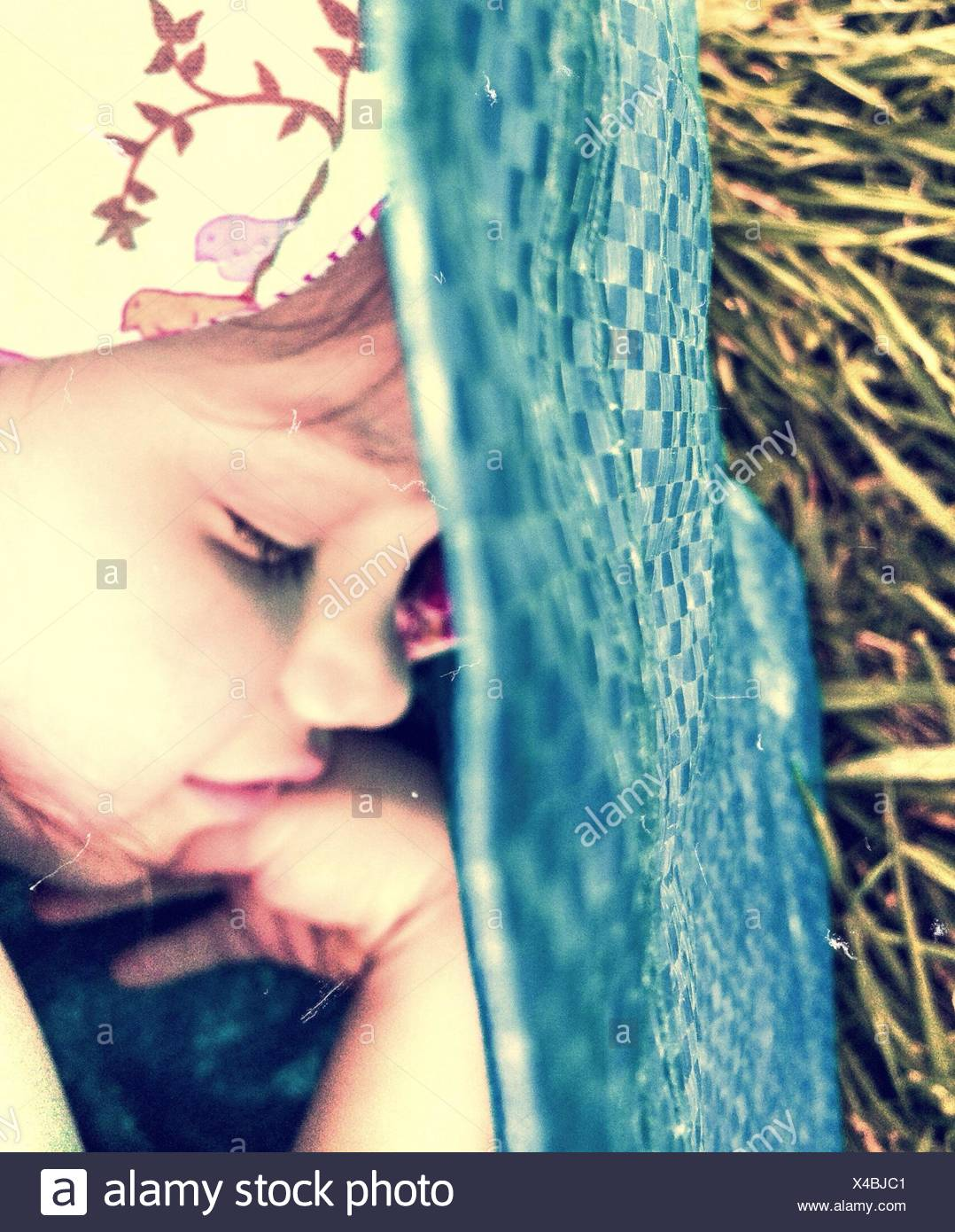 Close-Up Of Cute Young Girl Sleeping - Stock Image