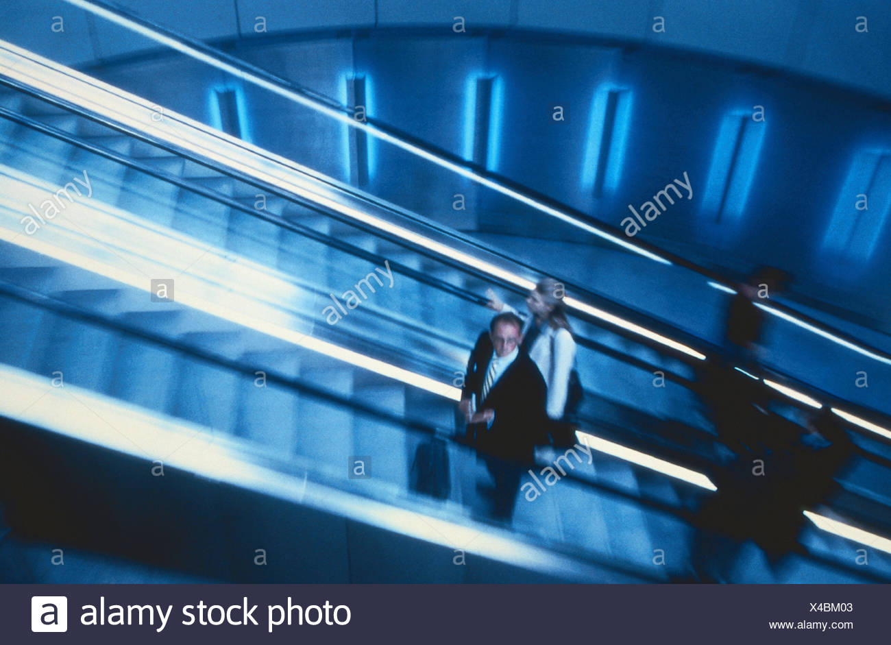 Airport terminals, detail, escalator, travellers, inside, airport, Dusseldorf, manager, upward, stairs, movably, personal transport, promotion, business people, go away, arrival - Stock Image