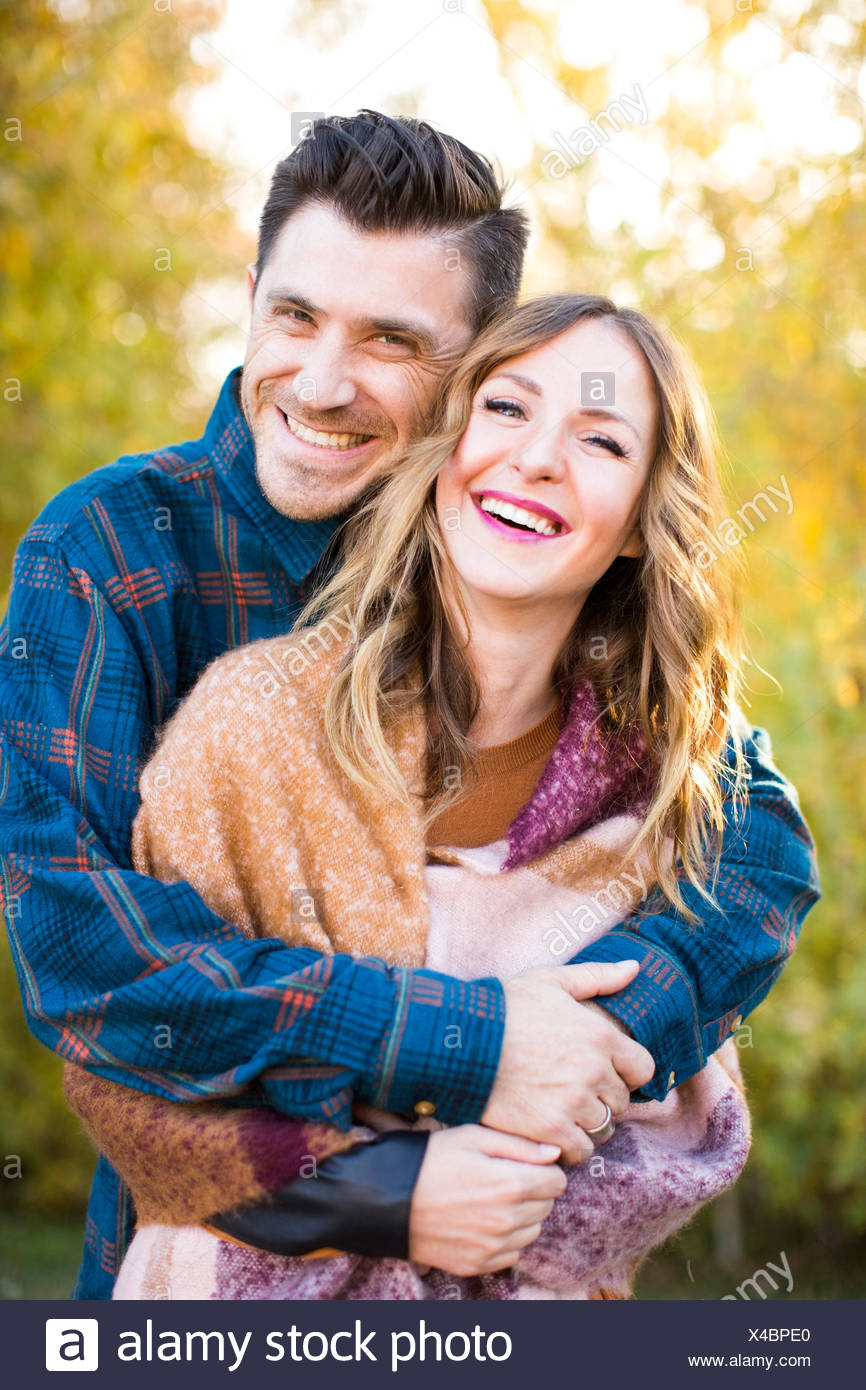 Smiling mid-adult couple - Stock Image