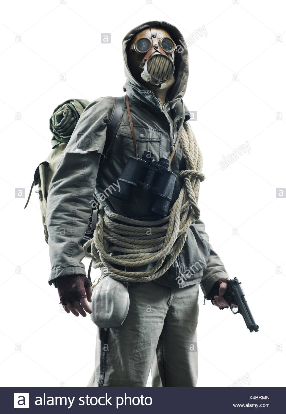 Post apocalyptic survivor in gas mask on white background - Stock Image