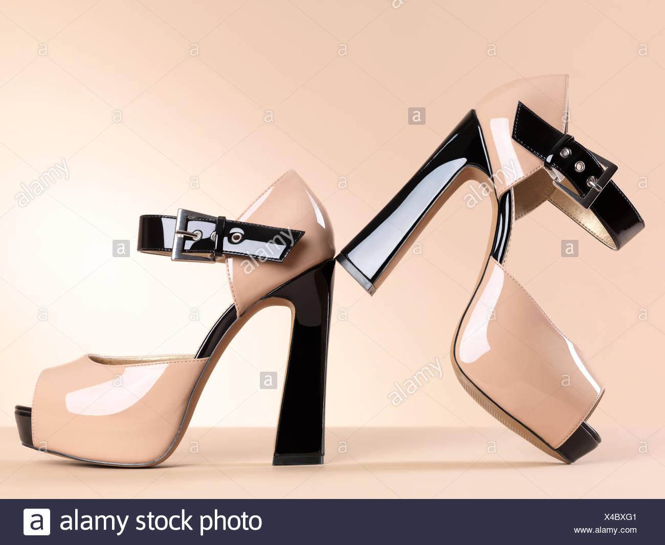 Shiny open-toe high heels - Stock Image