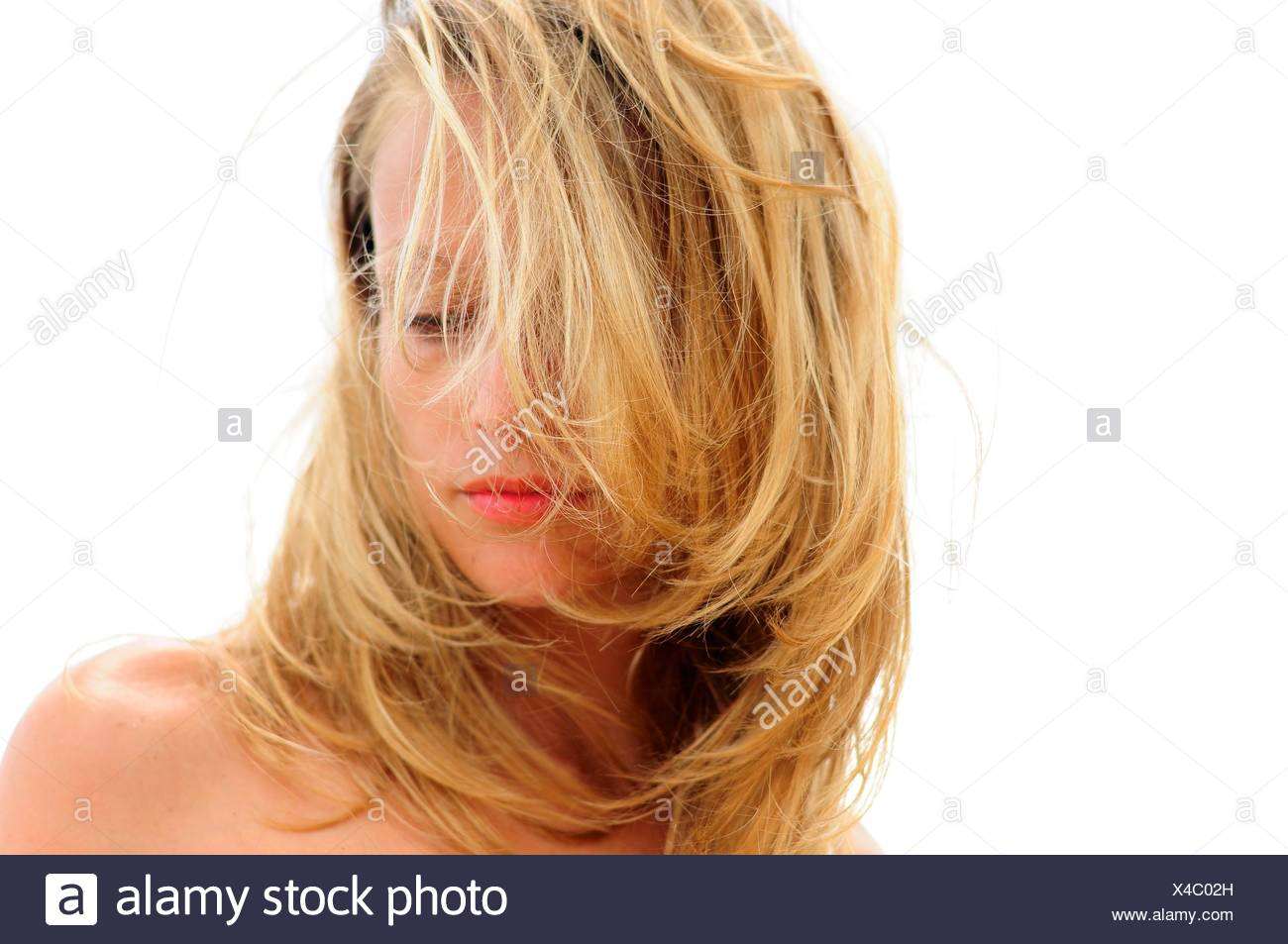 Woman with hair covering face - Stock Image