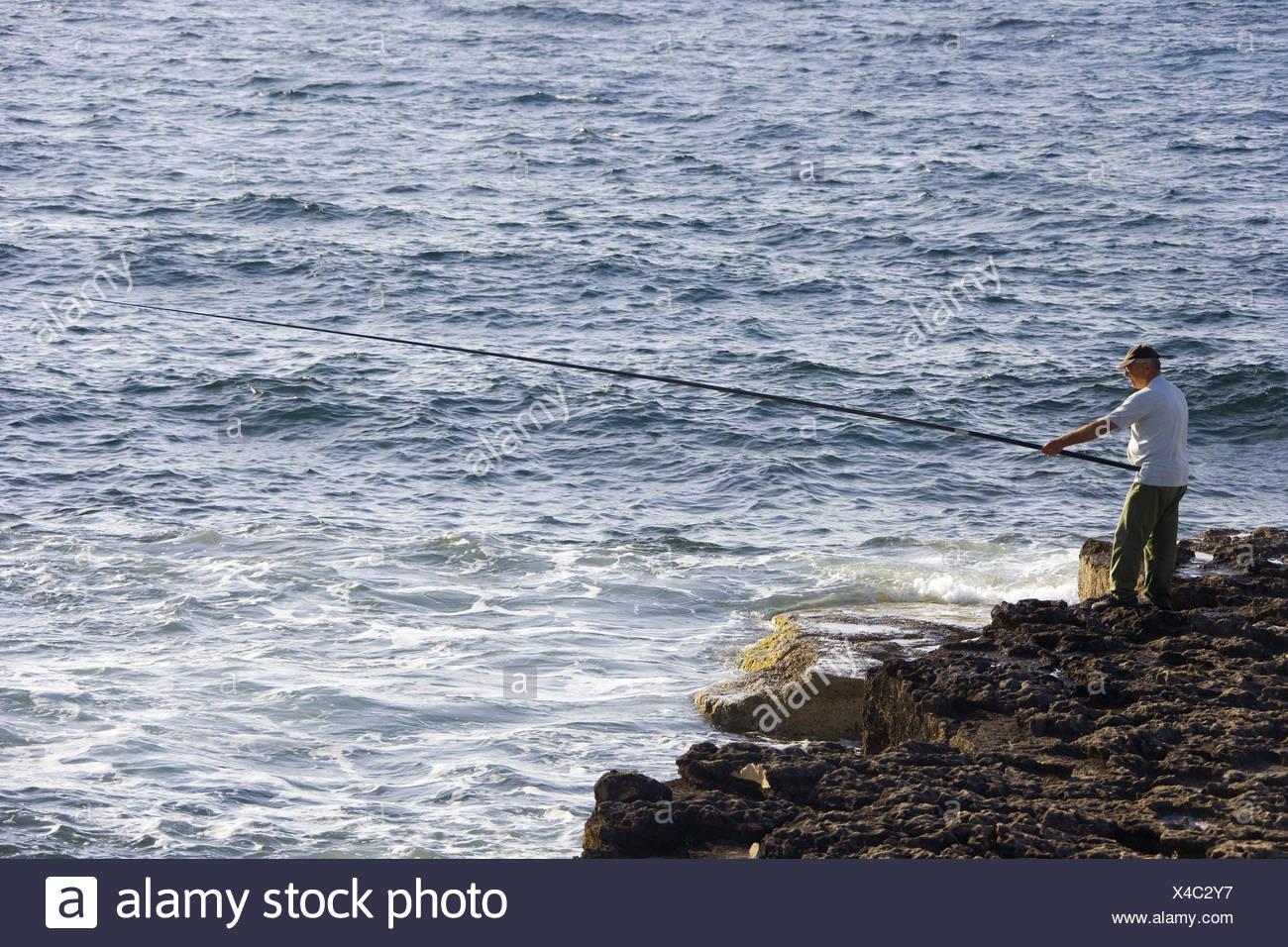 Cyprus, bile coast, angler, sea, - Stock Image