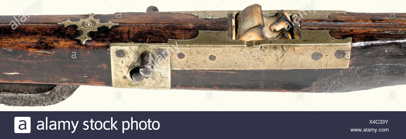 A crossbow, Spain, 16th century Heavy iron prod, with several smith marks (POURA?) stamped into the top. Ridged bow irons. Hemp bowstring. Slender walnut tiller with delicately bevelled brass furniture. Small iron stirrup and studs on the side for a cocking lever. The side of the arrow groove bears chased ornamentation. Replacement bone nut. Long, slightly curved trigger. Length 83 cm. historic, historical, 16th century, crossbow, crossbows, distance weapon, weapons, object, objects, clipping, cut out, cut-out, cut-outs, Additional-Rights-Clearances-NA - Stock Image