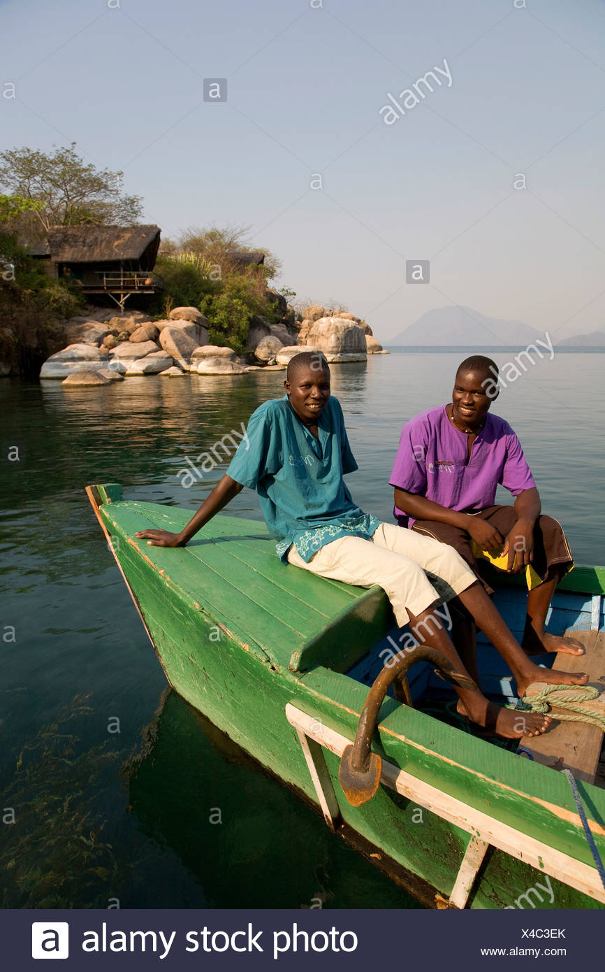 Staff on a boat, Mumbo Island Camp, Cape Maclear Peninsula, Lake Malawi, Malawi, South East Africa - Stock Image