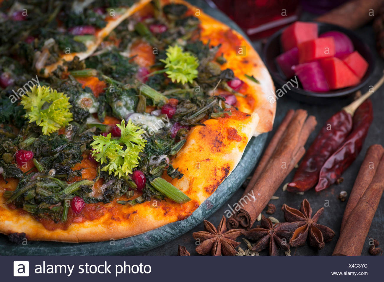 An Arabian manakish bread snack with herbs and spinach. Arab version of pizza - Stock Image