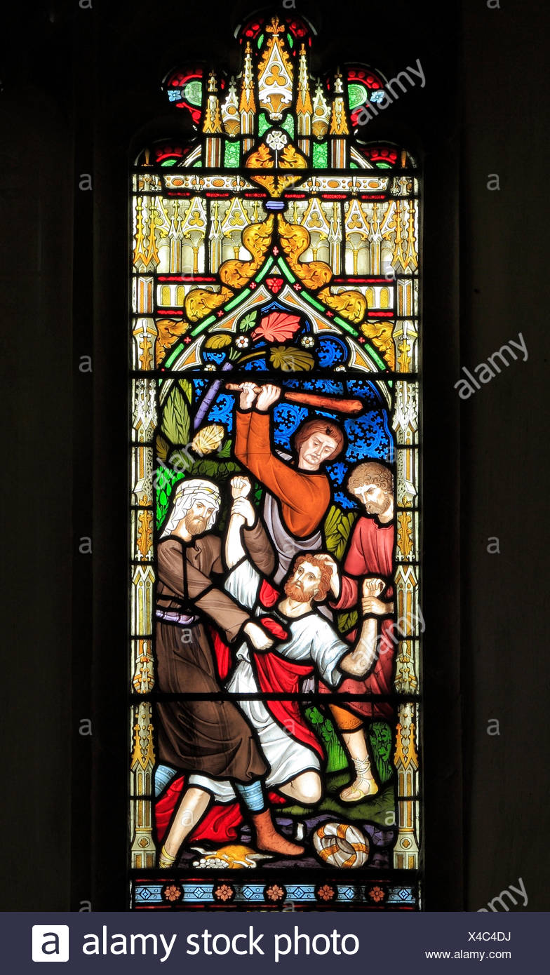 Parable of The Good Samaritan, stained glass window by Frederick Preedy, 1865, Traveller beaten and robbed by thieves, Gunthorpe, Norfolk, England, UK - Stock Image