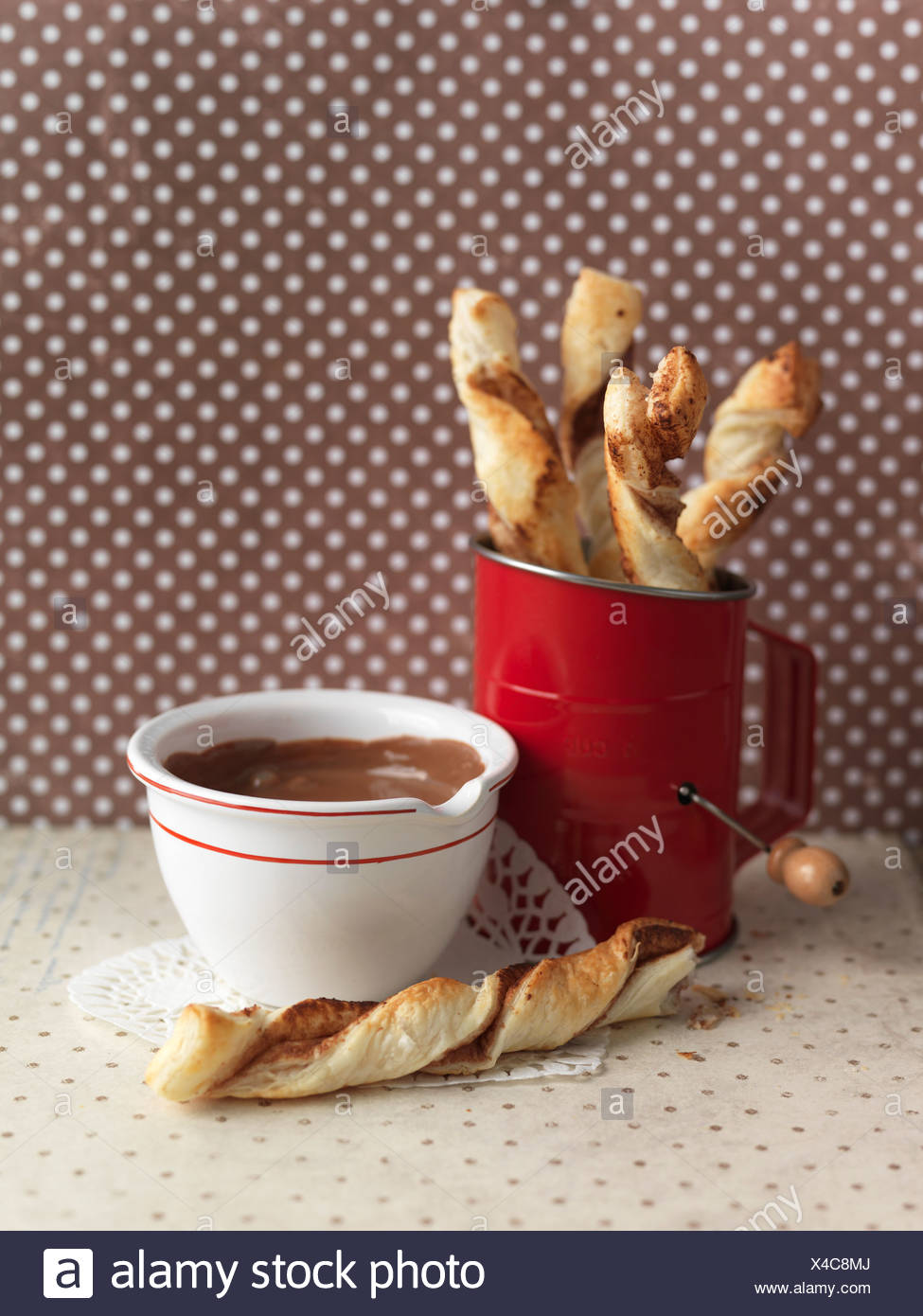 Flaky pastry twists and chocolate cream - Stock Image