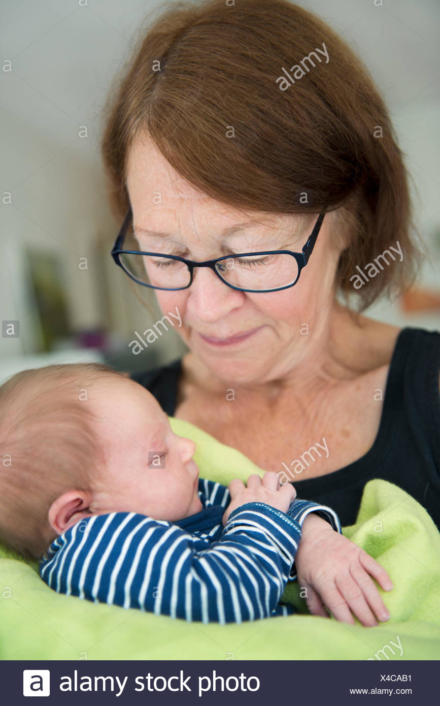 Sweden, Grandmother with newborn baby girl (0-1 months) - Stock Image