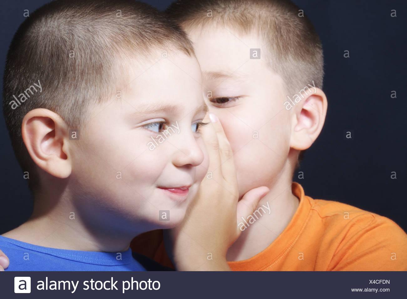 Brothers sharing secrets - Stock Image