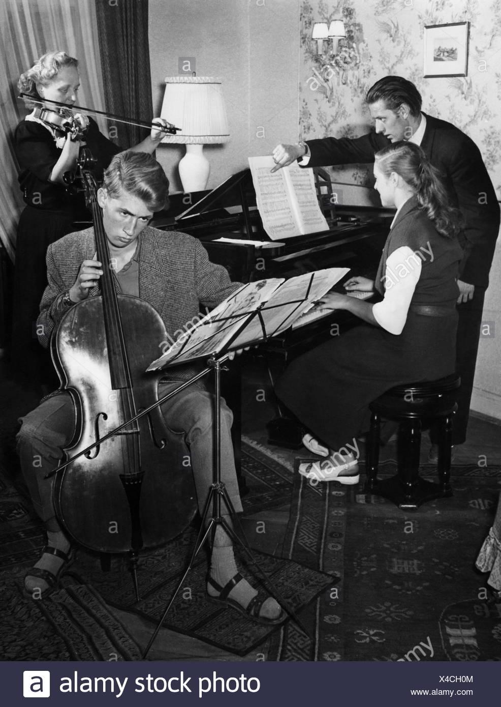 music, salon music, German family making music, 50s, Germany, piano