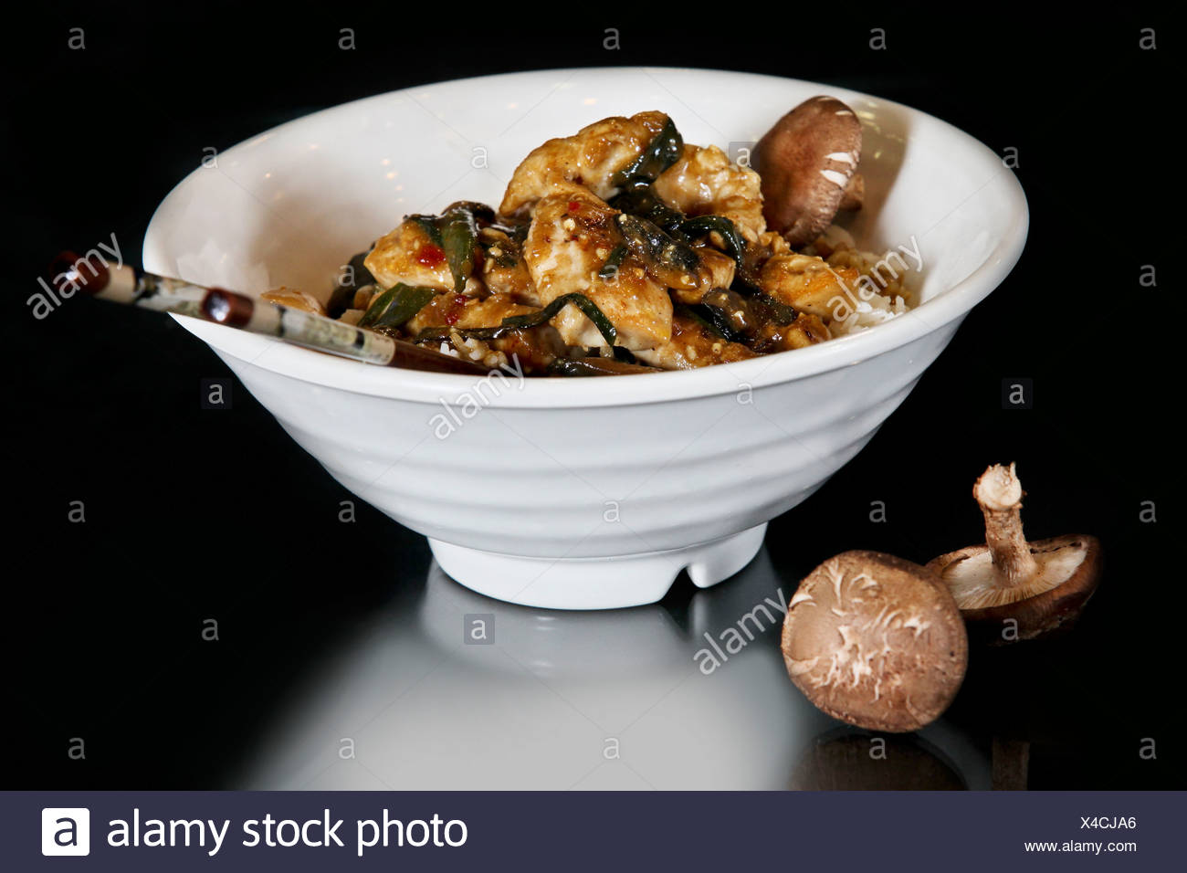 Thai stir fry meal with chicken and mushrooms - Stock Image