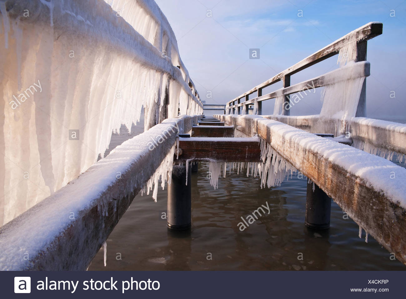 Jetty on the beach of the seaside resort Rettin, frosty winter day, - Stock Image