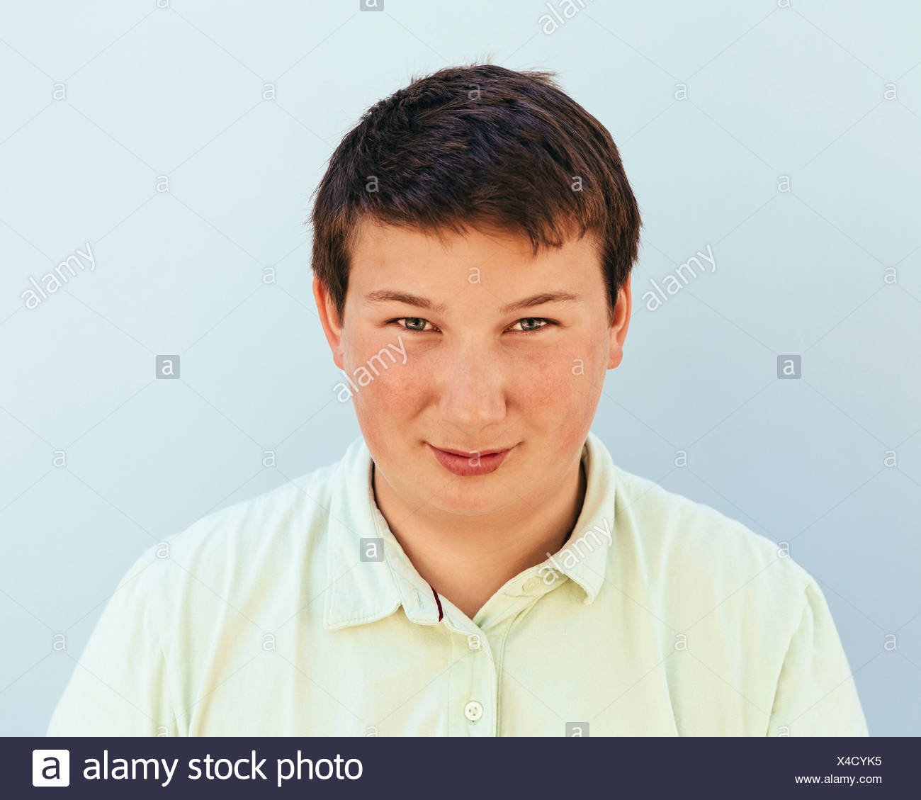 Portrait of a teenage boy with short black hair. - Stock Image