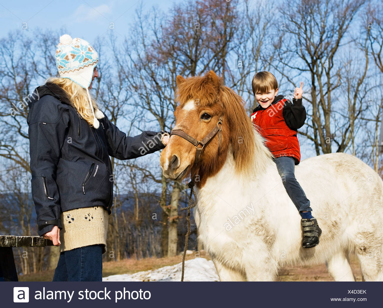 Mother and son with horse - Stock Image