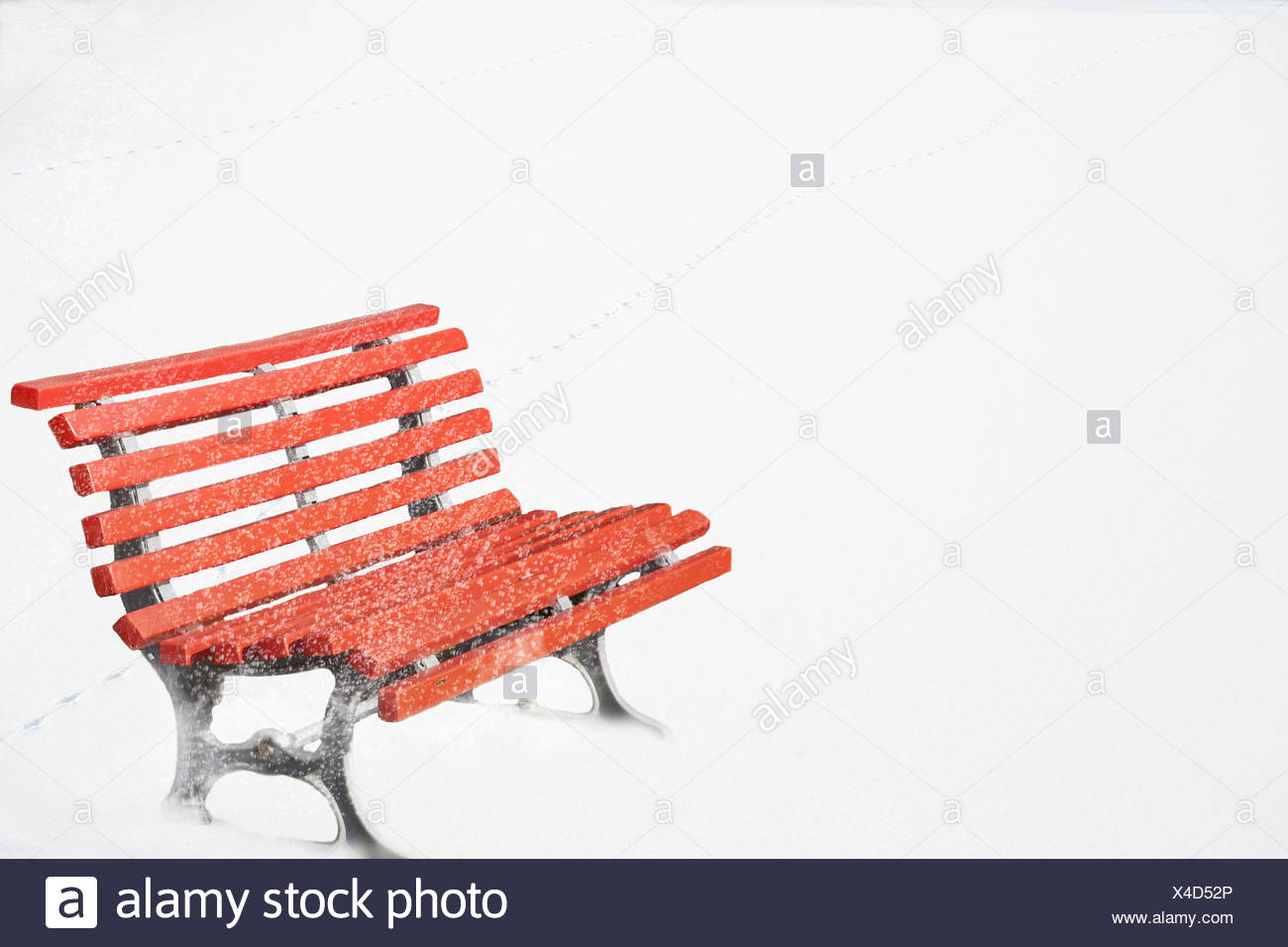 Red saddle, snow, winter, bank, garden bench, park-bench, red, blank, nobody, sit rest, rest, conception, unoccupied, white, radiant, contrast, colour, Colourfully, cut out, copy space, rib bank, seasons, snowfall, snow surface, snowflakes, tracks, animal tracks, - Stock Image