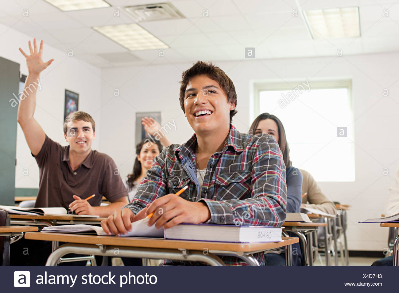 High school students sitting in classroom - Stock Image