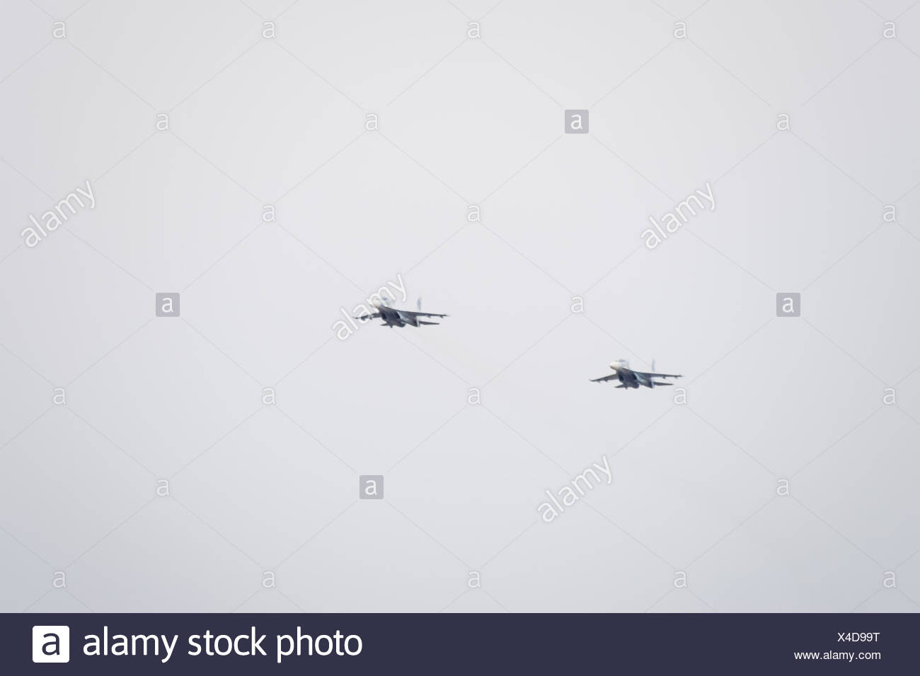 Air show in the sky above the Krasnodar airport flight school. Airshow in honor of Defender of the Fatherland. su-35 in the sky. - Stock Image