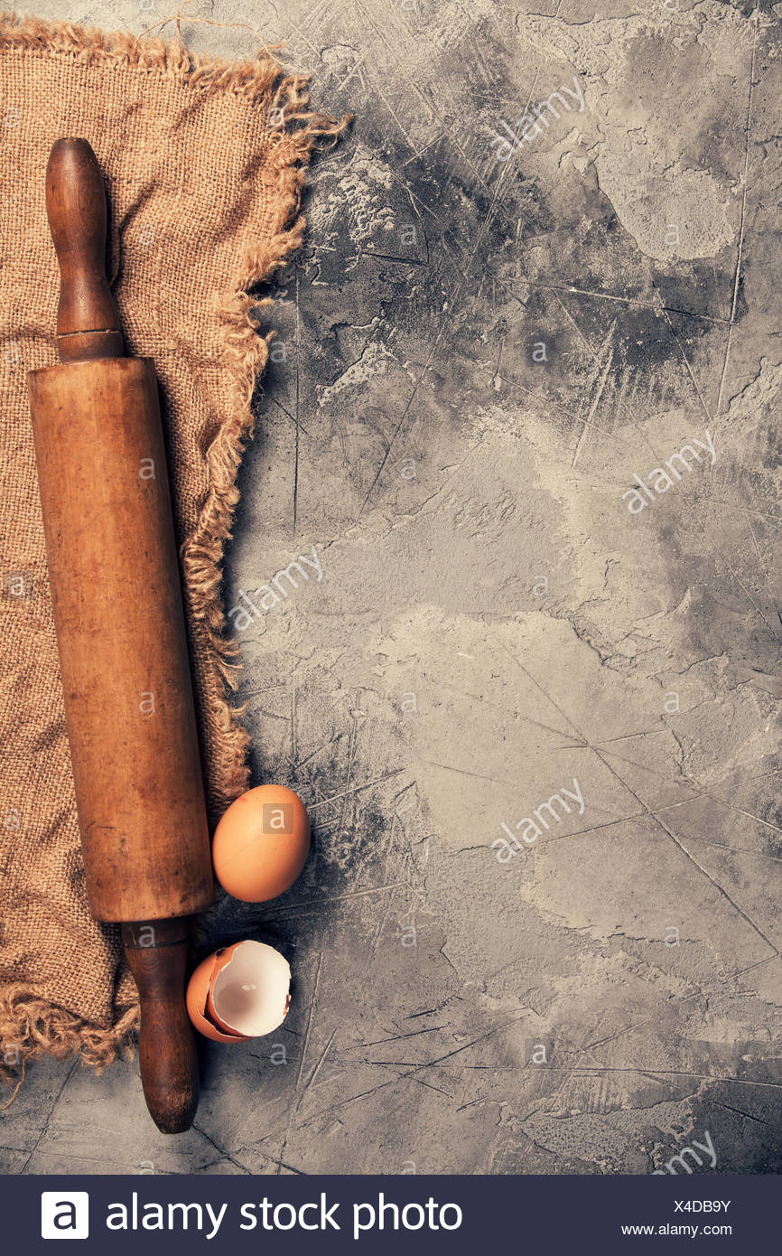 Top view on Old Kitchen cooking utensils on grey stone table - cooking concept - Stock Image