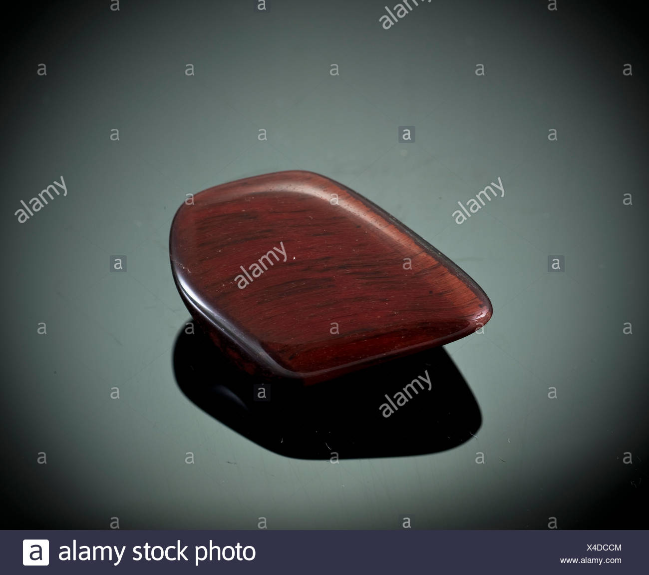 Cutout of a brecciated jasper gemstone on black background - Stock Image