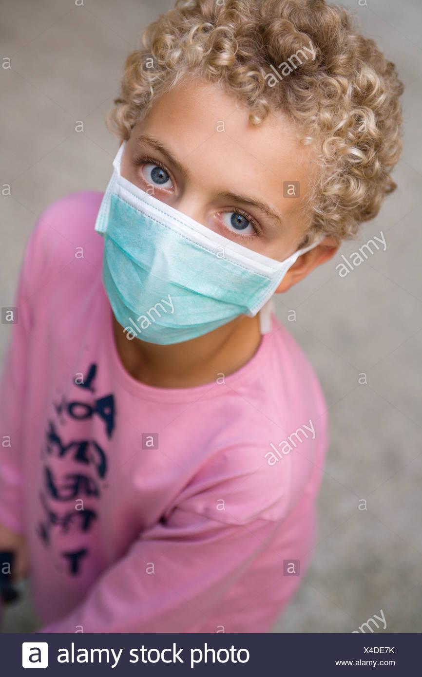 Boy with swine flu mask - Stock Image