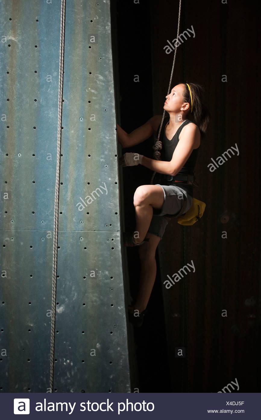 USA, Utah, Sandy, teenage girl (14-15) on indoor climbing wall - Stock Image