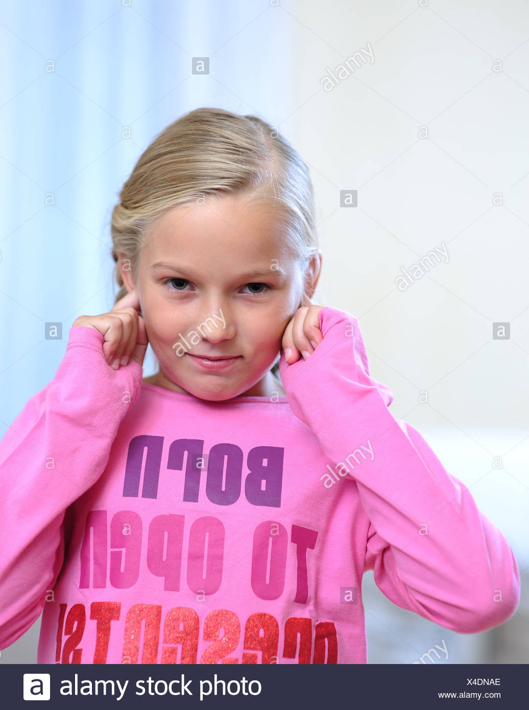Young Girl Stops One's Ears - Stock Image
