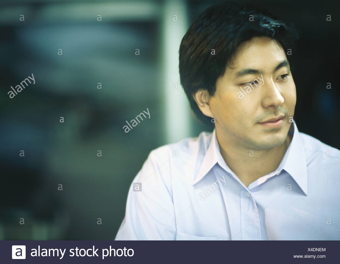Man in button down shirt - Stock Image