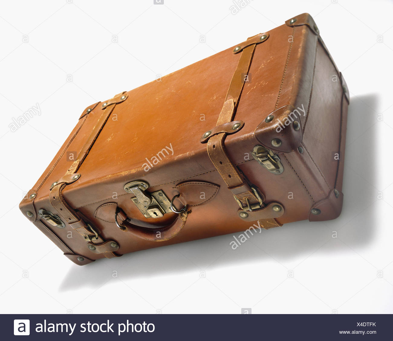 Studio photograph of Old antique leather suite case, on white Stock Photo