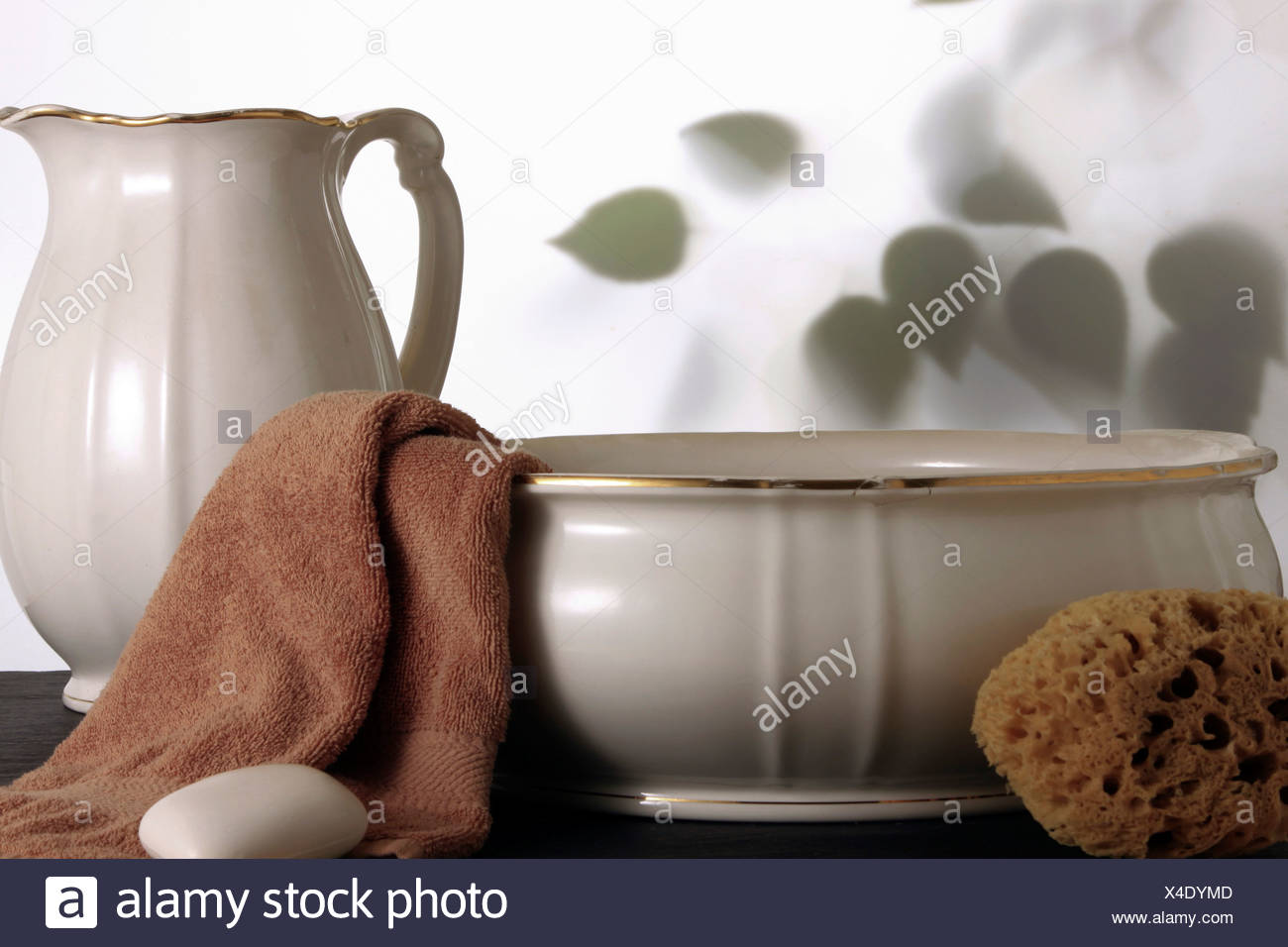 Old wash basin with towel, soap and sponge Stock Photo