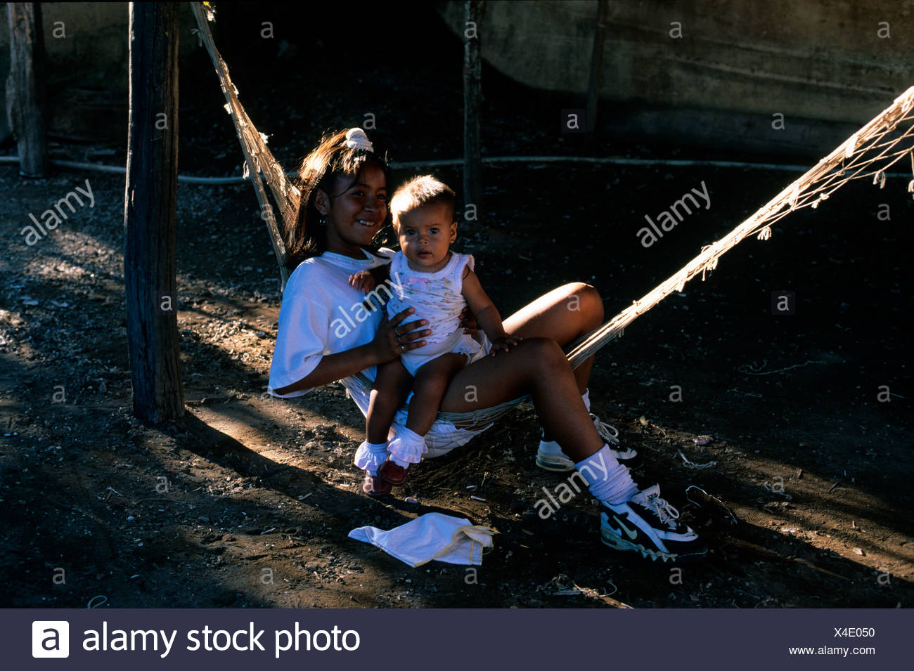 Mexico Nayarit Mexcaltitan children in hammock - Stock Image